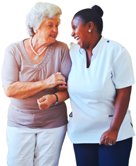 elderly woman talking with a caregiver